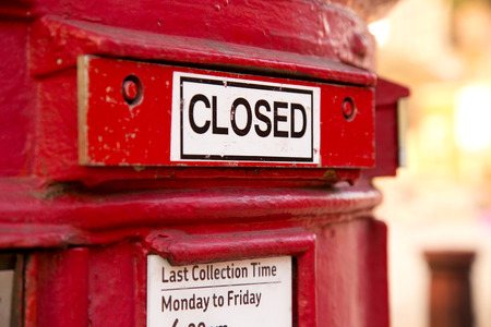 a closed red english letterbox. photo