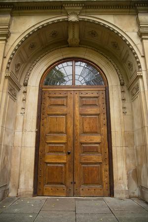 locked door: large solid wooden door.