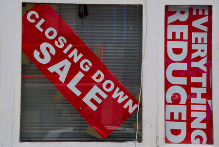 shop window: closing down sale sign in a window. Stock Photo