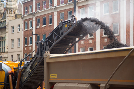 dumper: Construction workers operate a cold milling machine. Stock Photo