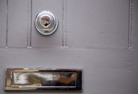 door knob and letter box. Stock Photo