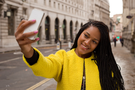 woman pose: young woman taking a selfie.