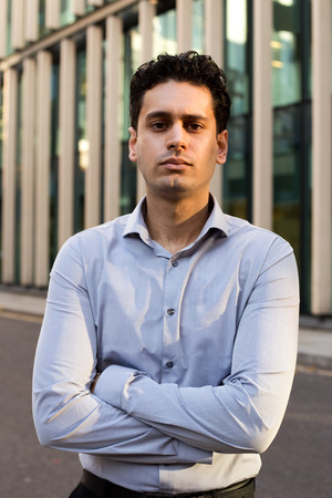young business man with crossed arms. Stock Photo