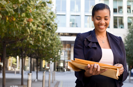 business woman holding enveloppes. photo