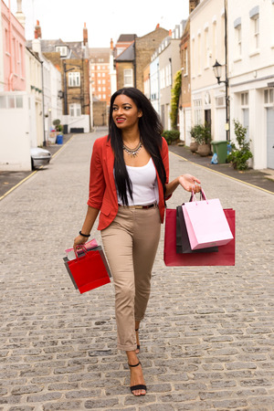 young woman walking with shopping bags photo