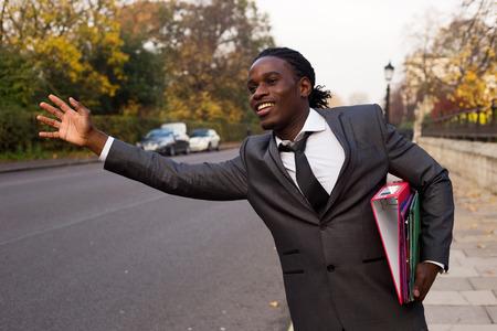 business man hailing a taxi photo