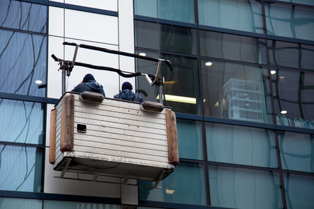 window cleaner: windoe cleaners at work