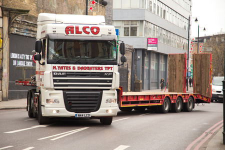 LONDON - NOVEMBER 25TH: A long alco truck navigates a sharp corner on November the 25th, 2014, in London, England, UK. ALCO Filters is a trusted name in more than 55 countries