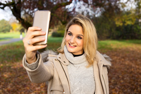 young woman taking a selfie photo
