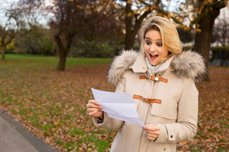 penfriend: surprised woman reading a letter Stock Photo