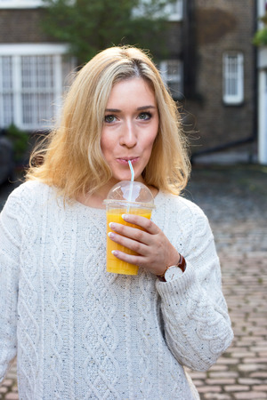 releaxed: young woman drinking a smoothie.