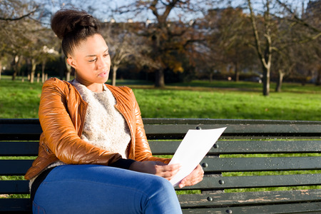 concerning: young woman reading a document