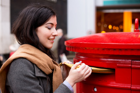 young woman posting letters