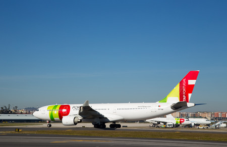 civilian: LISBON, PORTUGAL- January 9th, 2015: A Tap Portugal flight in Lisbon on the 9th of january 2015 Lisbon, Portugal. Tap is the national airline of Portugal Editorial