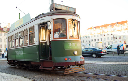 LISBON - JANUARY 9TH: An old traditional tram on January the 9th, 2015, in Lisbon, Portugal. Lisbons number 28 tram is one of the citys cultural attractions.