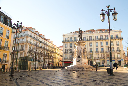 chiado: LISBON, PORTUGAL- January 11th, 2015: Statue of  luis de camoes  in Lisbon on the 11th of january 2015 Lisbon, Portugal. Chiado square is a popular shopping destination.