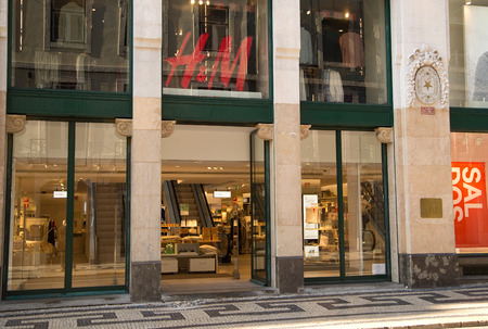 hm: LISBON, PORTUGAL- January 11th, 2015: The exterior of H&M in Lisbon on the 11th of january 2015 Lisbon, Portugal. H&M is a global clothing retailer. Editorial