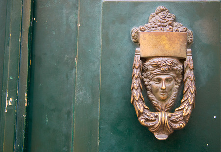 Ornamental door knocker. photo