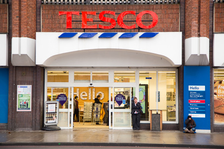 LONDON - JANUARY 21ST: The exterior of an Tescos express supermarket on January the 21tst, 2015, in London, England, UK. Tescos is one of the UKs leading supermarkets.