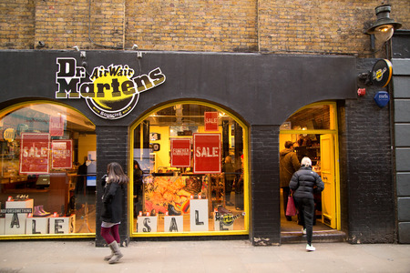 dr: LONDON - JANUARY 22nd: The exterior of Dr martens on January the 22nd, 2015, in London, England, UK. Dr Martens is a leading boot and shoe specialist.