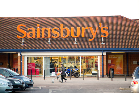 LONDON - JANUARY 23RD: The exterior of a Sainsburys supermarket on January the 23rd, 2015, in London, England, UK. Sainsburys is one of the UKs leading supermarkets.