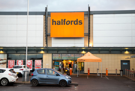car retailer: LONDON - FEBRUARY 5TH: The exterior of Halfords on February the 5th, 2015, in London, England, UK. Halfords are the leading retailer for leisure and car products
