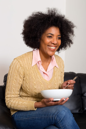 young woman enjoying breakfast photo