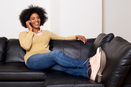 young african american woman talking on the phone. photo