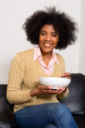 young woman having breakfast photo