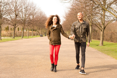 young couple walking in the park photo