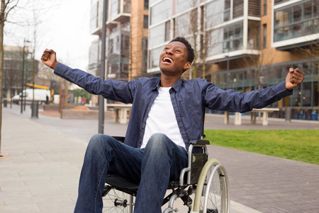 adult: a young wheelchair user celebrating.