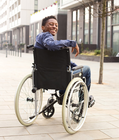 happy young man in a wheelchair