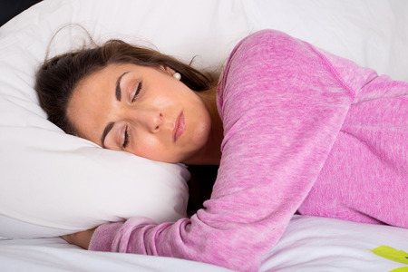drowsiness: young woman sleeping Stock Photo
