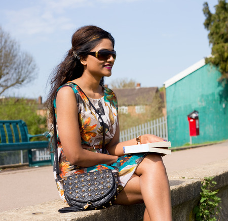 girl glasses: young woman enjoying a summer afternoon outdoors
