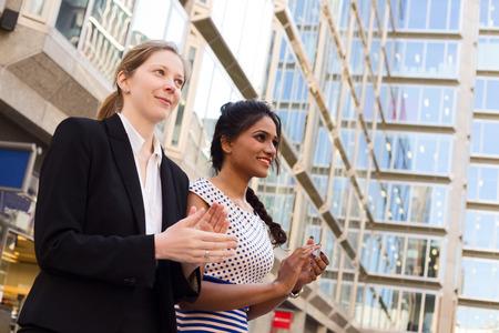 congratulating: young ladies congratulating their colleague