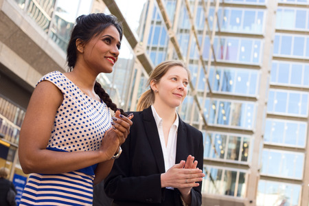outdoors woman: business women congratulating a colleague Stock Photo