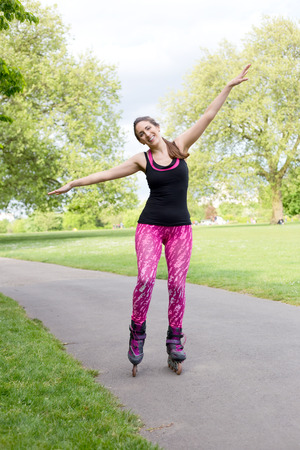 blading: happy woman in her roller skates Stock Photo
