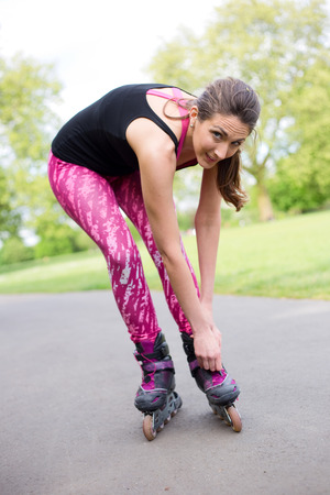 blading: young woman in the park with roller skates