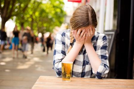 sad woman at the bar