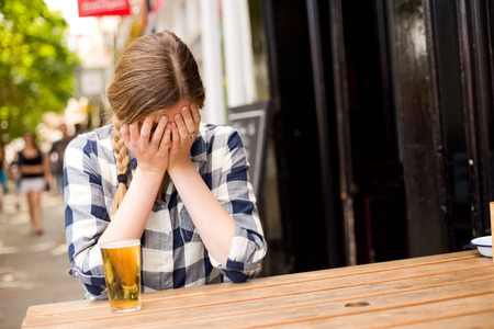 boozer: young woman upset at the pub crying