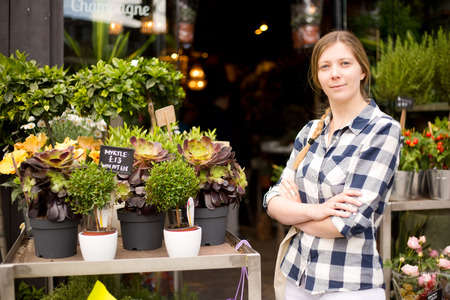 business woman standing outside her flower shop photo