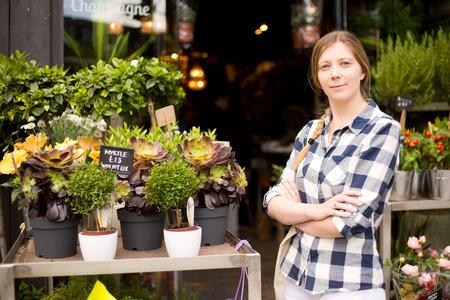 proprietor: business woman standing outside her flower shop