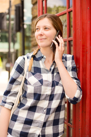 cell phone booth: young woman making a phone call in london Stock Photo