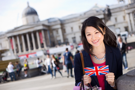 london people: young chinese tourist in trafalgar square