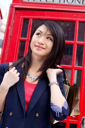 phonebooth: young chinese tourist in london Stock Photo