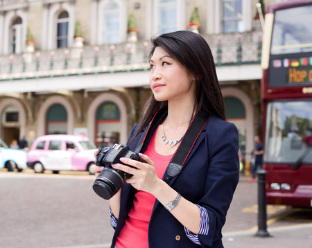 holiday destination: young chinese tourist in London Stock Photo