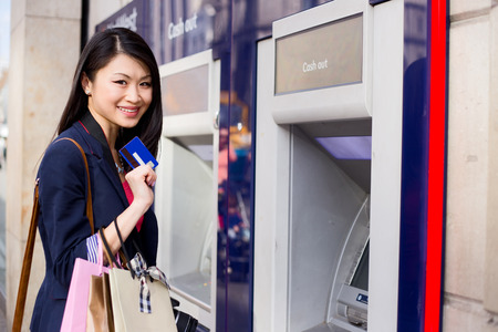 young chinese girl at the cash machine
