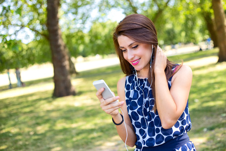 hands free device: young woman using her phone