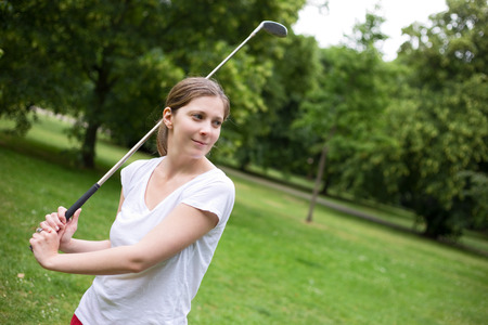 woman golf: young woman playing golf Stock Photo