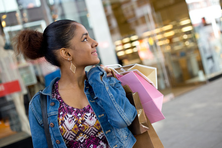 shop: young woman in the street with shopping bags